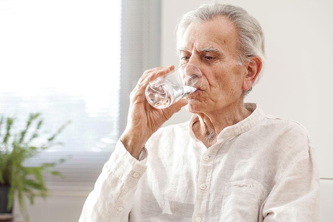 older man drinking boiled water